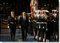 President George W. Bush reviews the troops at Ft. Myer in Arlington, Va., Tuesday, Jan. 6, 2009, during a military appreciation in his honor. With him is Col. Joseph Buche, Commander of Troops. White House photo by Joyce N. Boghosian