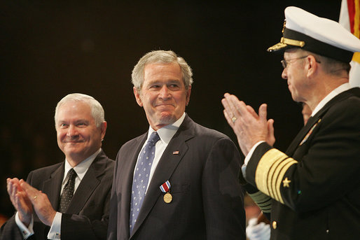 President George W. Bush glances at Admiral Mike Mullen, Chairman of the Joint Chiefs of Staff, as they stand with U.S. Secretary of Defense Robert Gates during a military tribute Tuesday, Jan. 6, 2009, at Ft. Myer in Arlington, Va. White House photo by Joyce N. Boghosian