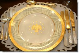 The George W. Bush State China, unveiled Wednesday, Jan. 7, 2009, at the White House by Mrs. Laura Bush, has a gold rim with a green basket-weave pattern and a historically-inspired gold eagle throughout the 14-piece place setting. The 320-place setting pattern will allow the White House to accommodate larger Rose Garden dinners and cover any breakage. The china was paid for by the White House Historical Association Acquisition Trust, a non-profit organization. White House photo by Shealah Craighead