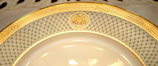 The rim of the George W. Bush State China, unveiled Wednesday, Jan. 7, 2009, at the White House by Mrs. Laura Bush, shows the two distinctive design elements of the china – a green basket-weave pattern and a historically-inspired gold eagle – throughout the 14-piece place setting. The new 320-place setting china will allow the White House to accommodate larger Rose Garden dinners and cover any breakage. The china was paid for by the White House Historical Association Acquisition Trust, a non-profit organization. White House photo by Shealah Craighead