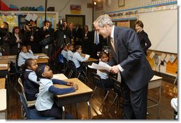 President George W. Bush talks with a young student during his visit with Mrs. Laura Bush to a second grade class Thursday, Jan. 8, 2008 at the General Philip Kearny School in Philadelphia. President Bush followed his class visit with an address on the No Child Left Behind Act, urging Congress to strenghten and reauthorize the legislation. White House photo by Chris Greenberg