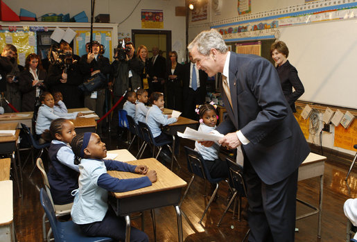 President George W. Bush talks with a young student during his visit with Mrs. Laura Bush to a second grade class Thursday, Jan. 8, 2009 at the General Philip Kearny School in Philadelphia. President Bush followed his class visit with an address on the No Child Left Behind Act, urging Congress to strenghten and reauthorize the legislation. White House photo by Chris Greenberg