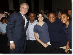 President George W. Bush poses with a group of students Thursday, Jan. 8, 2008, following his address at the General Philip Kearny School in Philadelphia, where President Bush spoke about the success of the No Child Left Behind Act and urged Congress to strenghten and reauthorize the legislation. White House photo by Chris Greenberg