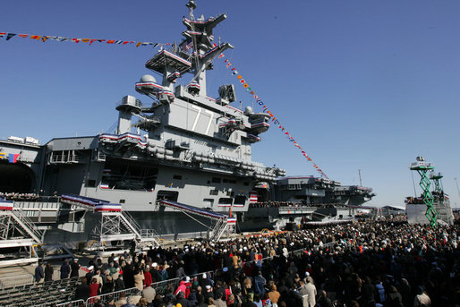 Guests and U.S. Navy personnel crowd the dock at the commissioning ceremony of the USS George H.W. Bush (CVN 77) aircraft carrier Saturday, Jan 10, 2009 in Norfolk, Va., named in honor of former President George H.W. Bush. White House photo by Joyce N. Boghosian