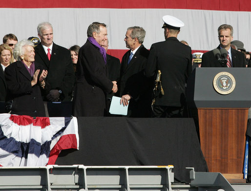 President George W. Bush shakes hands with his father, former President George H.W. Bush following President Bush's remarks in honor of his father at the commissioning ceremony of the USS George H.W. Bush (CVN 77) aircraft carrier Saturday, Jan 10, 2009 in Norfolk, Va. White House photo by Joyce N. Boghosian