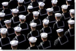U.S. Navy Sailors stand at attention Saturday, Jan. 10, 2009, during commissioning ceremonies for the USS George H.W. Bush (CVN 77) aircraft carrier in Norfolk, Va. White House photo by David Bohrer