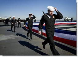"The crew of the USS George H.W. Bush (CVN 77) aircraft carrier ceremonially run aboard as the ship ""comes alive"" Saturday, Jan. 10, 2009, during commissioning ceremonies in Norfolk, Va. White House photo by David Bohrer"
