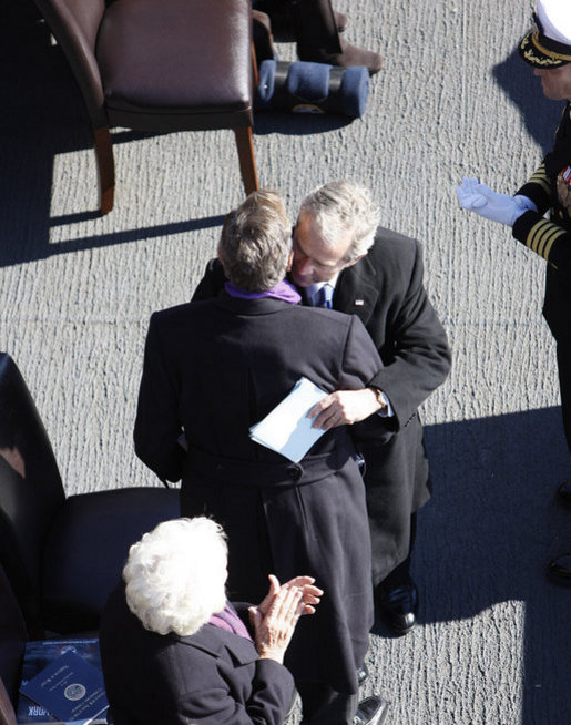 President George W. Bush embraces his father, former President George H. W. Bush, following his remarks honoring his father during the commissioning ceremony of the USS George H. W. Bush (CVN 77) aircraft carrier Saturday, Jan 10, 2009 in Norfolk, Va. White House photo by Eric Draper