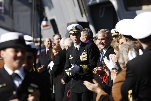 President George W. Bush watches as the crew comes aboard at the commissioning ceremony of the USS George H. W. Bush (CVN 77) aircraft carrier Saturday, Jan 10, 2009 in Norfolk, Va., named in honor of President Bush's father, former President George H. W. Bush. White House photo by Eric Draper