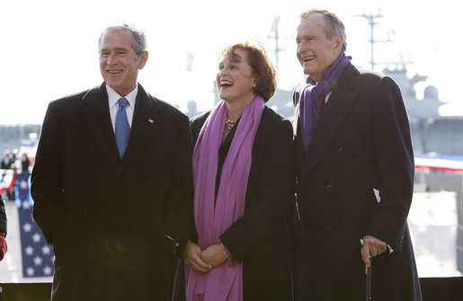 President George W. Bush stands with his sister, Doro Bush Koch, and their father, former President George H. W. Bush at the commissioning ceremony of the USS George H. W. Bush (CVN 77) aircraft carrier Saturday, Jan 10, 2009 in Norfolk, Va. White House photo by Eric Draper