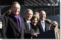 President George W. Bush stands with his father, former President George H. W. Bush and Mrs. Laura Bush during the commissioning ceremony of the USS George H. W. Bush (CVN 77) aircraft carrier Saturday, Jan 10, 2009 in Norfolk, Va. White House photo by Eric Draper