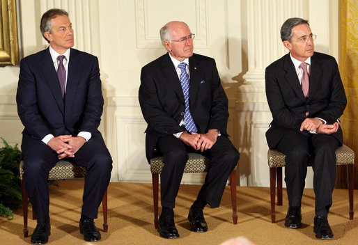 Former Prime Minister Tony Blair of the United Kingdom, is joined by Australia's former Prime Minister John Howard and Colombian President Alvaro Uribe as they sit onstage in the East Room of the White House Tuesday, Jan. 13, 2009, during a ceremony honoring them as 2009 recipients of the Presidential Medal of Freedom. Established by Executive Order in 1963, the medal is America's highest civil award. White House photo by Chris Greenberg