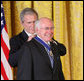 "Former Prime Minister John Howard of Australia, smiles as President George W. Bush presents him with the 2009 Presidential Medal of Freedom Tuesday, Jan. 13, 2009, during ceremonies in the East Room of the White House. Established in 1963, the Medal may be presented to ""any person who has made an especially meritorious contribution to the security or national interests of the United States, or world peace or cultural or other significant public or private endeavors."" White House photo by Chris Greenberg"
