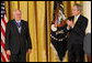 President George W. Bush applauds former Prime Minister John Howard after presenting the Australian leader with the 2009 Presidential Medal of Freedom during ceremonies Tuesday, Jan.13, 2009, in the East Room of the White House. White House photo by Chris Greenberg