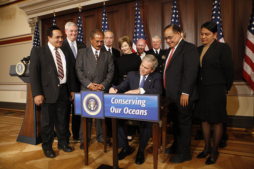 President George W. Bush signs one of three proclamations designating new Marine National Monuments in the Pacific during an event Tuesday, January 6, 2009, in the Eisenhower Executive Office Building. Joining in the signing ceremony were Mrs. Laura Bush, EPA Administrator Stephen Johnson, Interior Secretary Dirk Kempthorne, Commerce Secretary Carlos Gutierrez, Secretary Don Winter, Department of the Navy; Admiral Gary Roughead, Chief of Naval Operations; Bill Brennan, Administrator, National Oceanic and Atmospheric Administration, Department of Commerce; Governor Benigno Fitial, Northern Mariana Islands; Lelei Peau, Deputy Director, American Samoa Department of Commerce; Ray Tulafono, Director, American Samoa Department of Marine and Wildlife Resources; and Jim Connaughton, Chairman, Council of Environmental Quality. White House photo by Chris Greenberg