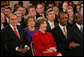 Mrs Laura Bush smiles as she listens to President George W. Bush deliver his farewell address to the nation Thursday evening, Jan. 15, 2009, from the East Room at the White House. White House photo by Joyce N. Boghosian