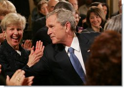 President George W. Bush reaches into the audience to shake hands with invited guests and staff members following his farewell address to the nation Thursday evening, Jan. 15, 2009 in the East Room of the White House, where President Bush thanked the American people for their support and trust.  White House photo by Joyce N. Boghosian