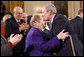 President George W. Bush kisses Arlene Howard on the forehead following his farewell address to the nation Thursday evening, Jan. 15, 2009 in the East Room of the White House. The President met Ms. Howard shortly after Sept. 11, 2001, where she gave him her son's police badge after he perished in the terrorists attacks on the World Trade Center. President Bush still carries the badge with him today as a reminder of all that was lost. White House photo by Eric Draper