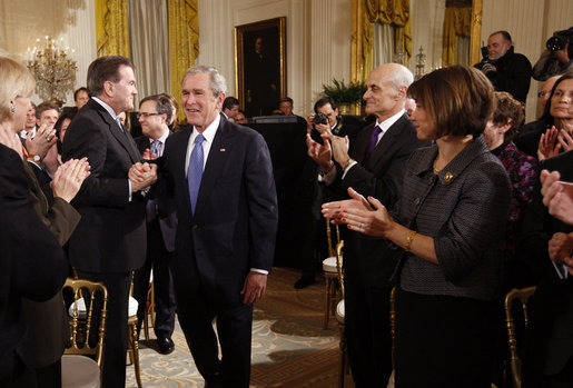 President George W. Bush grasps hands with Former Homeland Security Advisor, Tom Ridge, as he receives applause following his address to the nation Thursday evening, Jan. 15, 2009, from the East Room of the White House. White House photo by Eric Draper