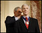 President George W. Bush places the Presidential Medal of Freedom to U.S. Ambassador to Iraq Ryan Crocker during a ceremony Thursday, Jan. 15, 2009, at the U.S. Department of State to commemorate foreign policy achievements. White House photo by Eric Draper