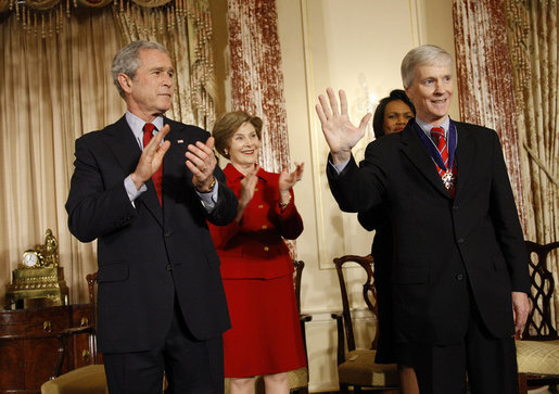 President George W. Bush and Mrs. Laura Bush applaud as U.S. Ambassador to Iraq Ryan Crocker acknowledges the audience after receiving the Presidential Medal of Freedom Thursday, Jan. 15, 2009, during a ceremony to commemorate foreign policy achievements at the U.S. Department of State. White House photo by Eric Draper
