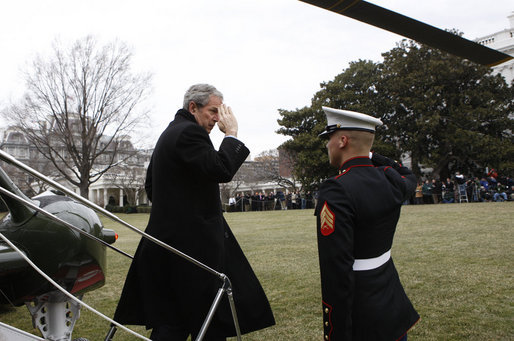President George W. Bush salutes a U.S. Marine crew member of Marine One upon his return to the White House Sunday, Jan. 18, 2009 from Camp David, which marks President Bush's final return to the South Lawn of the White House aboard the Presidential helicopter as President. White House photo by Chris Greenberg