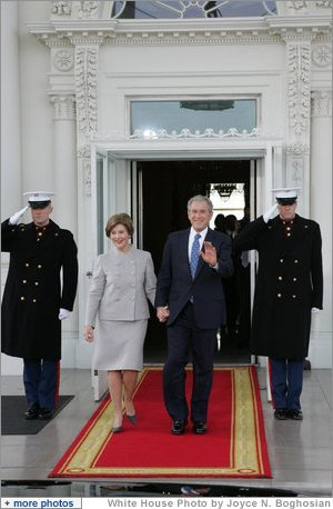 President George W. Bush and Mrs. Laura Bush walk out on the North Portico of the White House Tuesday morning, Jan. 20, 2008, to welcome President-Elect Barack Obama to the White House. White House photo by Joyce N. Boghosian