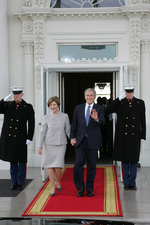 President George W. Bush and Mrs. Laura Bush walk out on the North Portico of the White House Tuesday morning, Jan. 20, 2009, to welcome President-Elect Barack Obama to the White House. White House photo by Joyce N. Boghosian