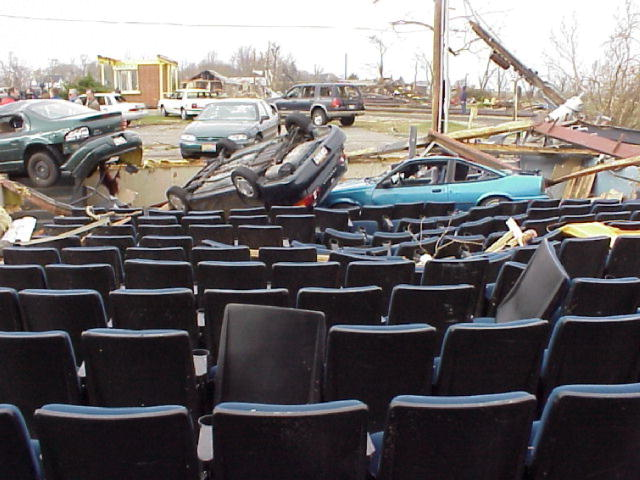 A picture of the Van Wert movie theatre after a tornade blew off the roof and walls and hurled cars into the seats.