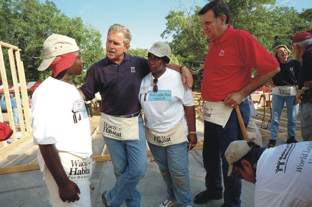 President Bush and Secretary Martinez at a Waco Habitat for Humanity building site.
