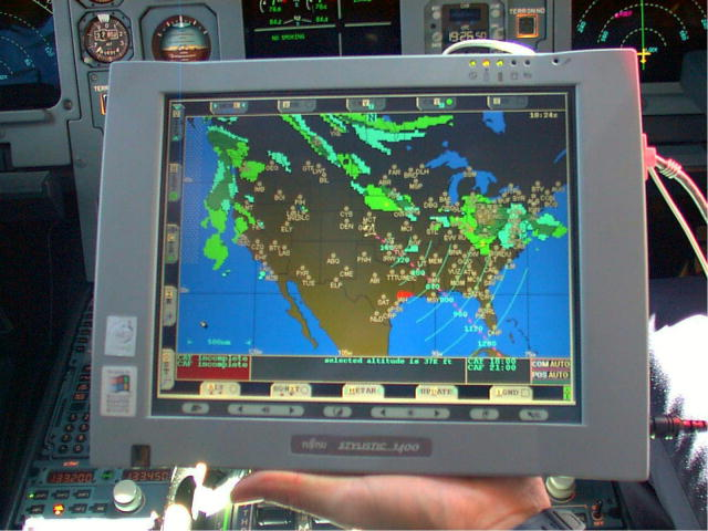 This photo shows a NASA graphical cockpit weather displays in an aircraft cockpit.