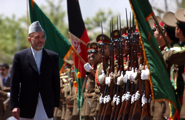 President Hamid Karzai entering the Kabul Military Training Center for the graduation of the 1st battalion, Afghanistan National Army.