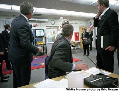 At Emma Booker Elementary School in Sarasota, Fla., President Bush watches video footage of the World Trade Tower attack. White House photo by Eric Draper.