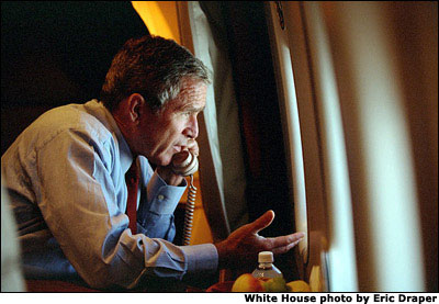 After departing Offitt Air Force Base, President Bush calls Vice President Cheney from Air Force One. White House photo by Eric Draper.