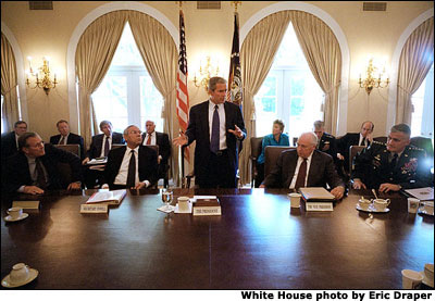 Meeting with his National Security Council in the Cabinet Room the morning after the attacks in New York City and Washington, D.C., President Bush outlines the new course of his administration. White House Photo by Eric Draper.