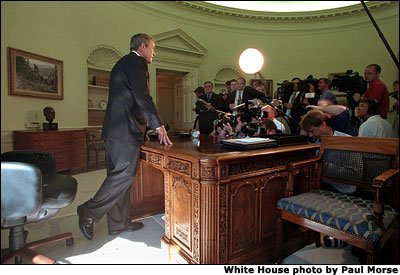After talking with Governor George Pataki and Mayor Rudolph Giuliani in a televised telephone conversation, President Bush addresses reporters in the Oval Office September 13. White House photo by Paul Morse.