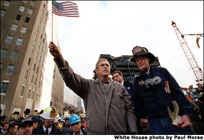 Standing upon the ashes of the worst terrorist attack on his country's soil, President Bush pledges that the voices from across America calling for justice will be heard Sept. 14. White House by Paul Morse.