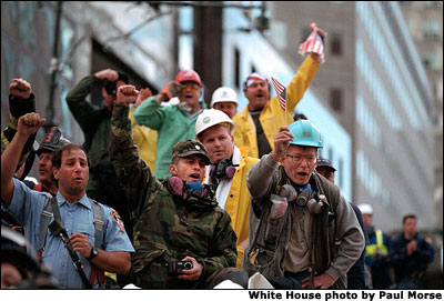 Rallying around President Bush's visit to New York Sept. 14, rescue workers cheer and chant,