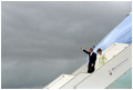 President George W. Bush waves as he and Laura Bush depart Air Force One upon arrival in Paris May 26, 2001.