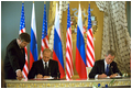 Presidents Bush and Putin sign a historic arms reduction treaty at the Kremlin in Moscow May 24.