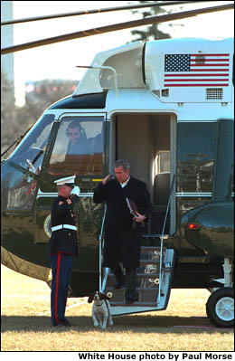 President Bush salutes an officer while Departing Marine One. White House photo by Paul Morse.