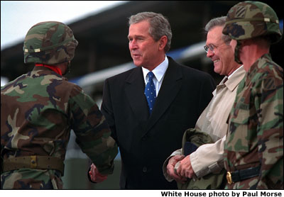President Bush shakes hands with soldiers. White House photo by Paul Morse.