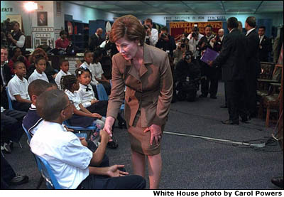 Laura Bush shakes hands with a student. White House photo by Carol Powers.