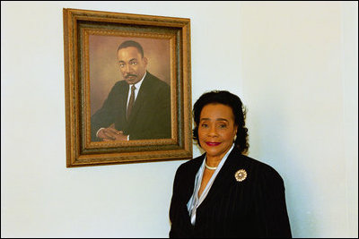 Coretta Scott King poses next to the portrait of her late husband, Dr ...