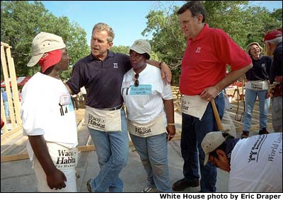 President Bush and Secretary for Housing and Urban Development Martinez, far right, talk with new friends during a break from their house-building efforts at the Waco, Texas, location of Habitat for Humanity's