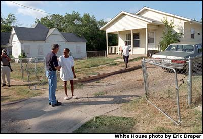 After helping build a house for Habitat for Humanity, President Bush meets some of his Waco neighbors. White House Photo by Eric Draper.