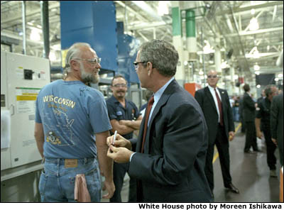 While touring Harley Davidson's Milwaukee factory, President Bush signs an employee's shirt during a visit Aug. 20. White House photo by Moreen Ishikawa.