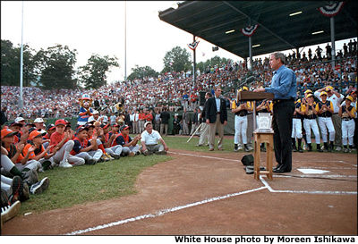 "President Bush kicks off the Little League World Series with a round of big hand shakes and thank you's. ""You prioritize your family and that's crucial for a healthy world, to make sure our families remain strong,"" said the President during his induction ceremony into Little League's Hall of Excellence Aug. 26 in Williamsport, Pa. ""I equate Little League baseball with good families."" White House photo by Moreen Ishikawa."