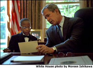 President Bush shares a letter with this year's March of Dimes ambassador in a meeting in the Oval Office. White House photo by Moreen Ishikawa.