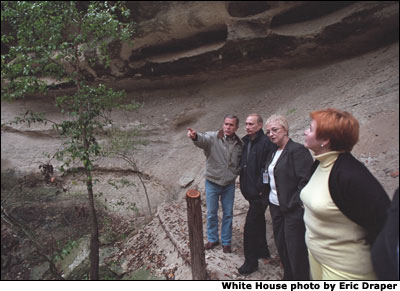 President George W. Bush and Russian President Vladimir Putin tour a canyon and waterfall at the Bush Ranch in Crawford, Texas, Wednesday, Nov. 14, 2001. Also pictured are Russian First Lady Lyudmila Putin, far right, and interpreter Irene Firsow. White House photo by Eric Draper.